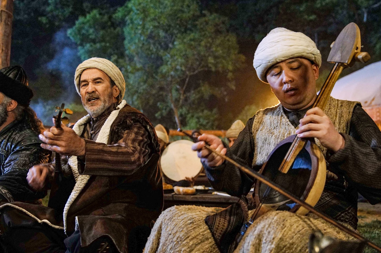 "Still shot shows Arslanbek Sultanbekov (L) performing ""Osman Bey"" march in the ""Kuruluş Osman"" series."