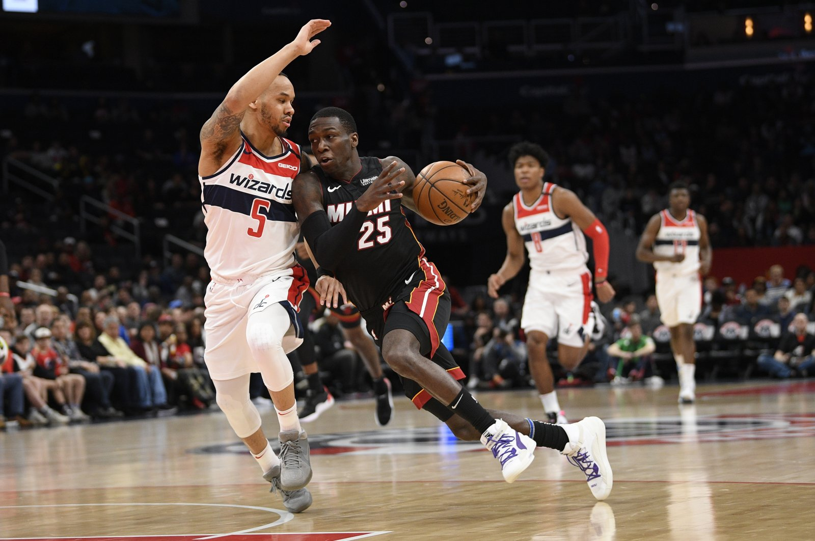 Miami Heat guard Kendrick Nunn (25) drives to the basket against Washington Wizards guard Shabazz Napier (5) during an NBA game, in Washington, D.C., U.S., March 8, 2020. (AP Photo)