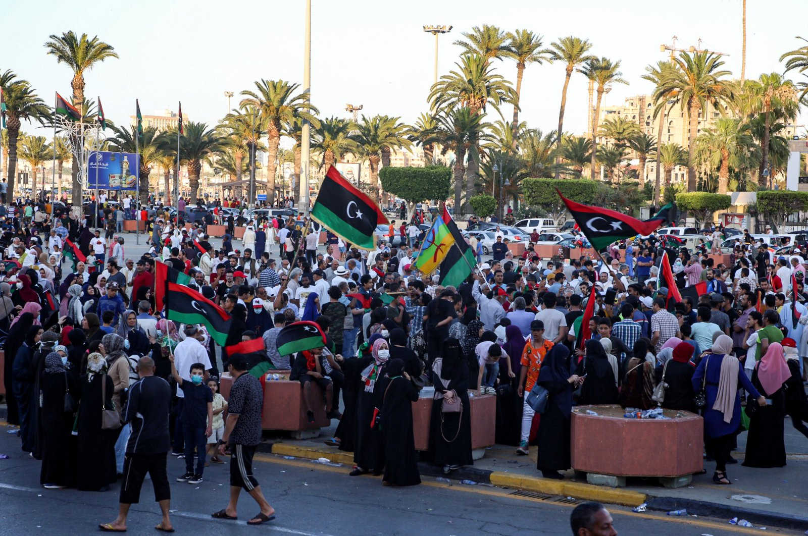 People celebrate with Libyan national flags in the capital Tripoli's Martyrs' Square, after the U.N.-recognized Government of National Accord (GNA) captured the town of Tarhuna from forces loyal to putschist Gen. Khalifa Haftar, June 5, 2020. (AFP Photo)
