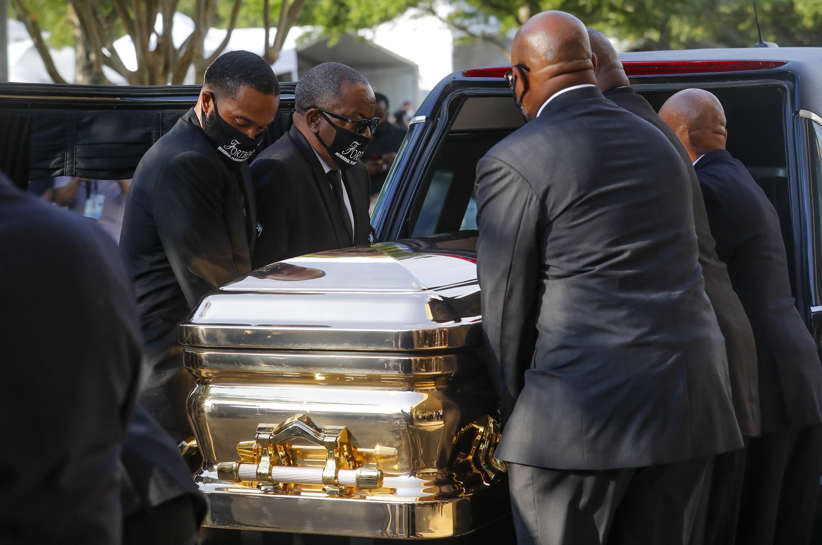 George Floyd's casket is loaded into a hearse after being brought out of The Fountain of Praise church following a public visitation, in Houston, Texas, U.S., June 8, 2020. (EPA-EFE Photo)