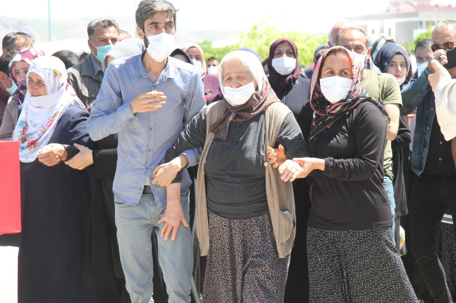 People mourn in a funeral ceremony organized for the victims of a PKK attack in eastern Van province, June 9, 2020. (SABAH)