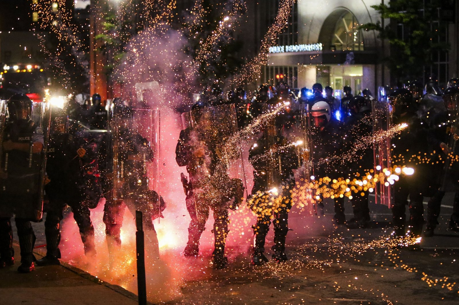 Fireworks go off in front of police at a protest in front of police headquarters in St. Louis, Missouri, U.S., June 1, 2020. (AP Photo)