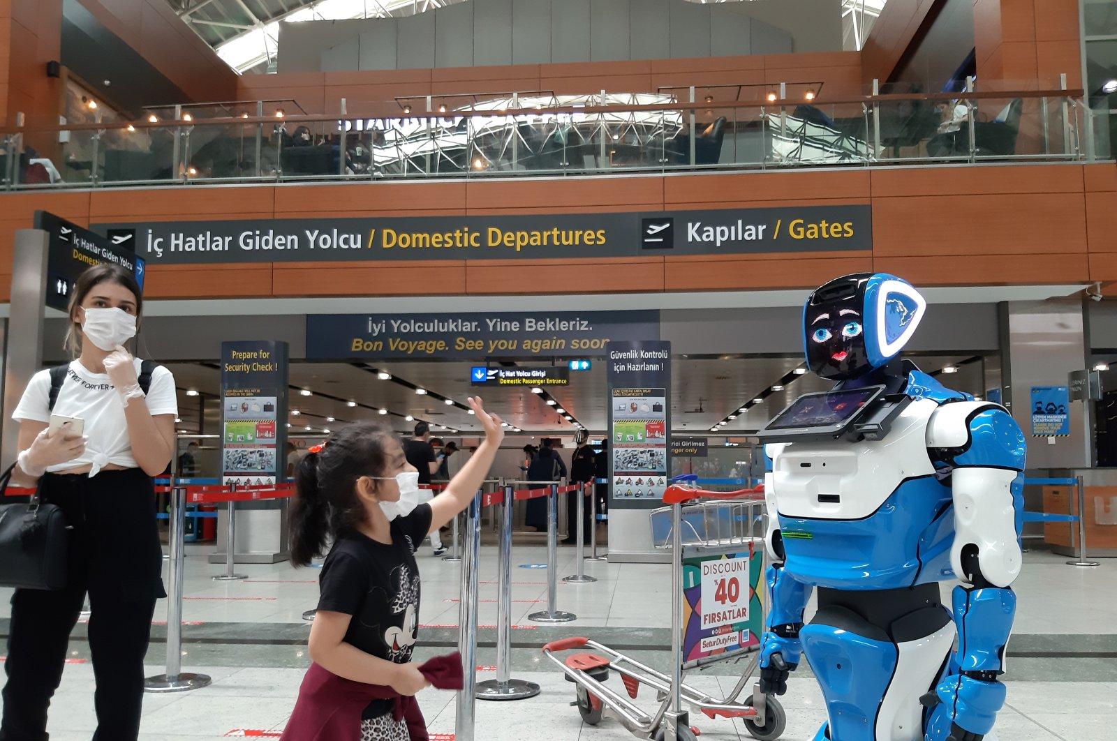 """Aerobot"" at Istanbul's Sabiha Gökçen Airport informs passengers about flights while warning on measures against the coronavirus outbreak. (AA Photo)"