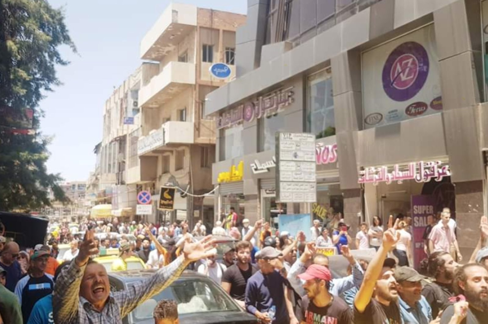 This photo taken from Twitter shows citizens protesting against the Assad regime in Syria's Sweida, May 8, 2020