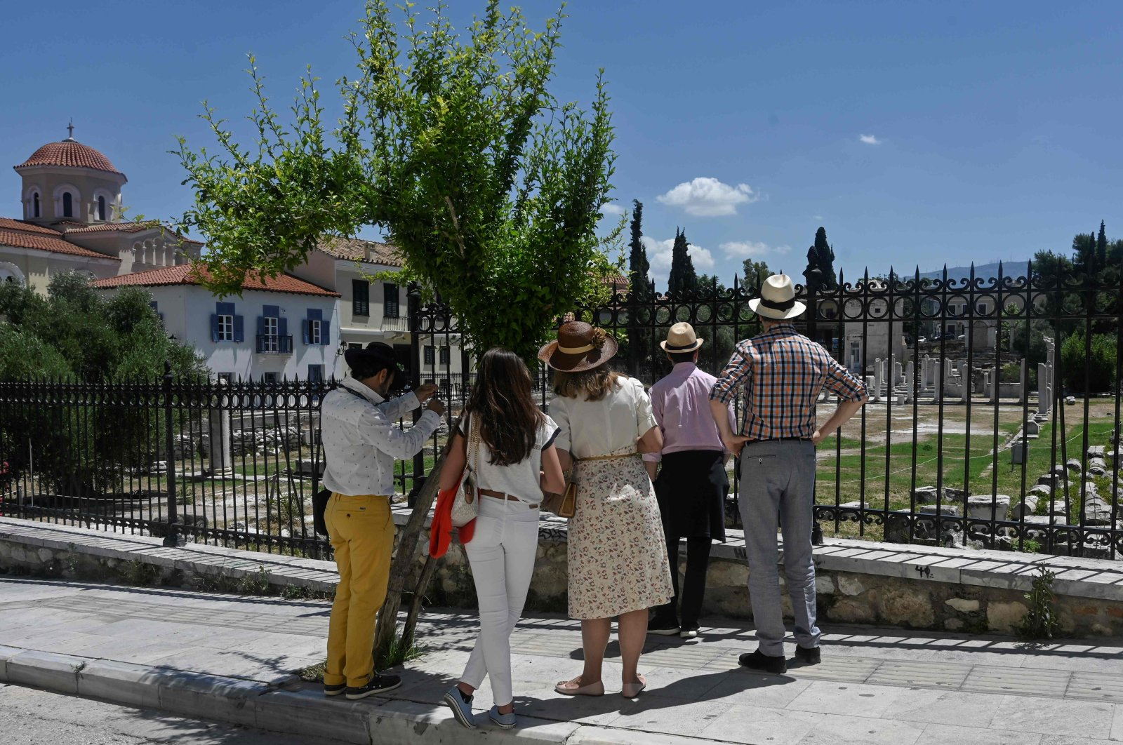 Italians tourists look at the roman agora in Athens on June 4, 2020, as Greece eases lockdown measures taken to curb the spread of the COVID-19. (AFP Photo)