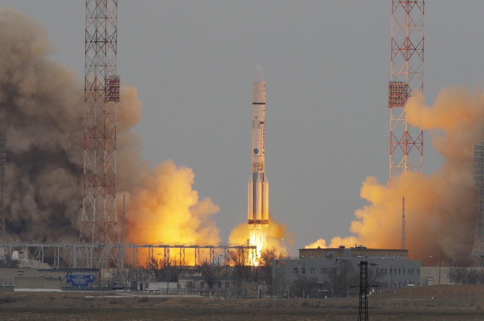 The Proton-M rocket booster blasts off at the Russian leased Baikonur cosmodrome, Kazakhstan, Monday, March 14, 2016. The Russian rocket carries an orbiter for measuring atmospheric gases of Mars and a Mars lander of the 'ExoMars 2016' mission. 'ExoMars 2016' is an astrobiology mission by the European Space Agency (ESA) in collaboration with the Russian Federal Space Agency. (AP Photo)