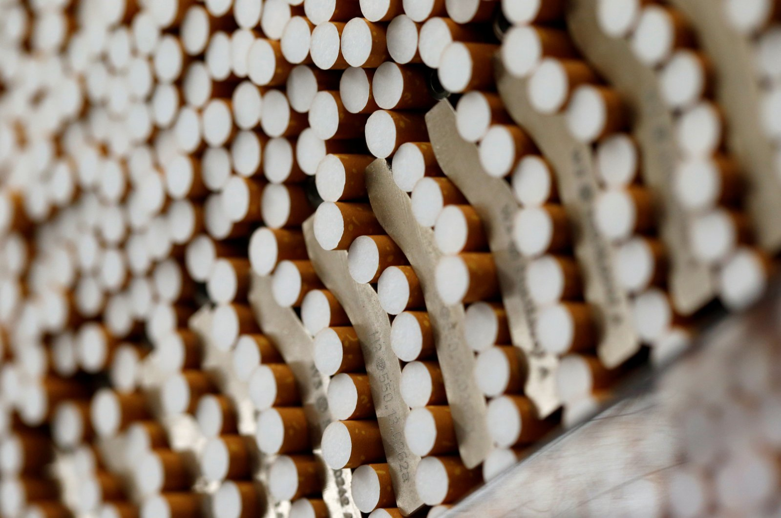 Cigarettes are seen during the manufacturing process in the British American Tobacco Cigarette Factory (BAT) in Bayreuth, southern Germany, April 30, 2014. (Reuters Photo)