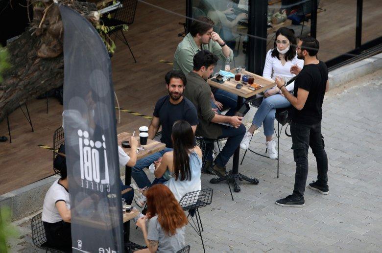 People sit outside a cafe, in Ankara, Turkey, Saturday, June 6, 2020. (AP Photo)