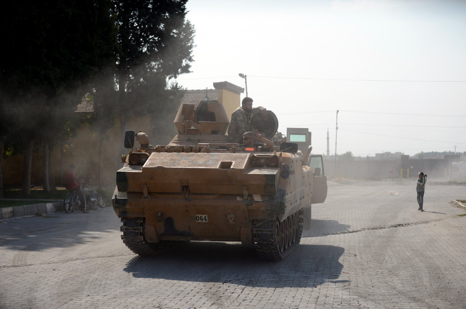Syrian National Army soldiers patrol the streets in Tal Abyad, Syria, on October 21, 2020 (IHA File Photo)