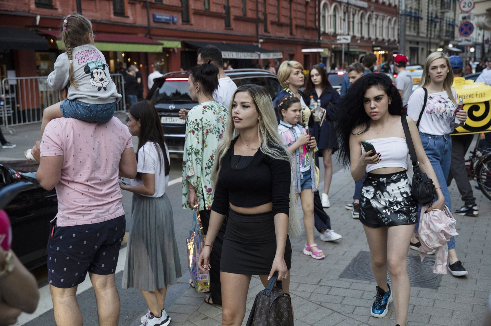 People walk on the first day that lockdown measures were eased at Patriarch Ponds in Moscow, Russia, June 9, 2020. (AP Photo)
