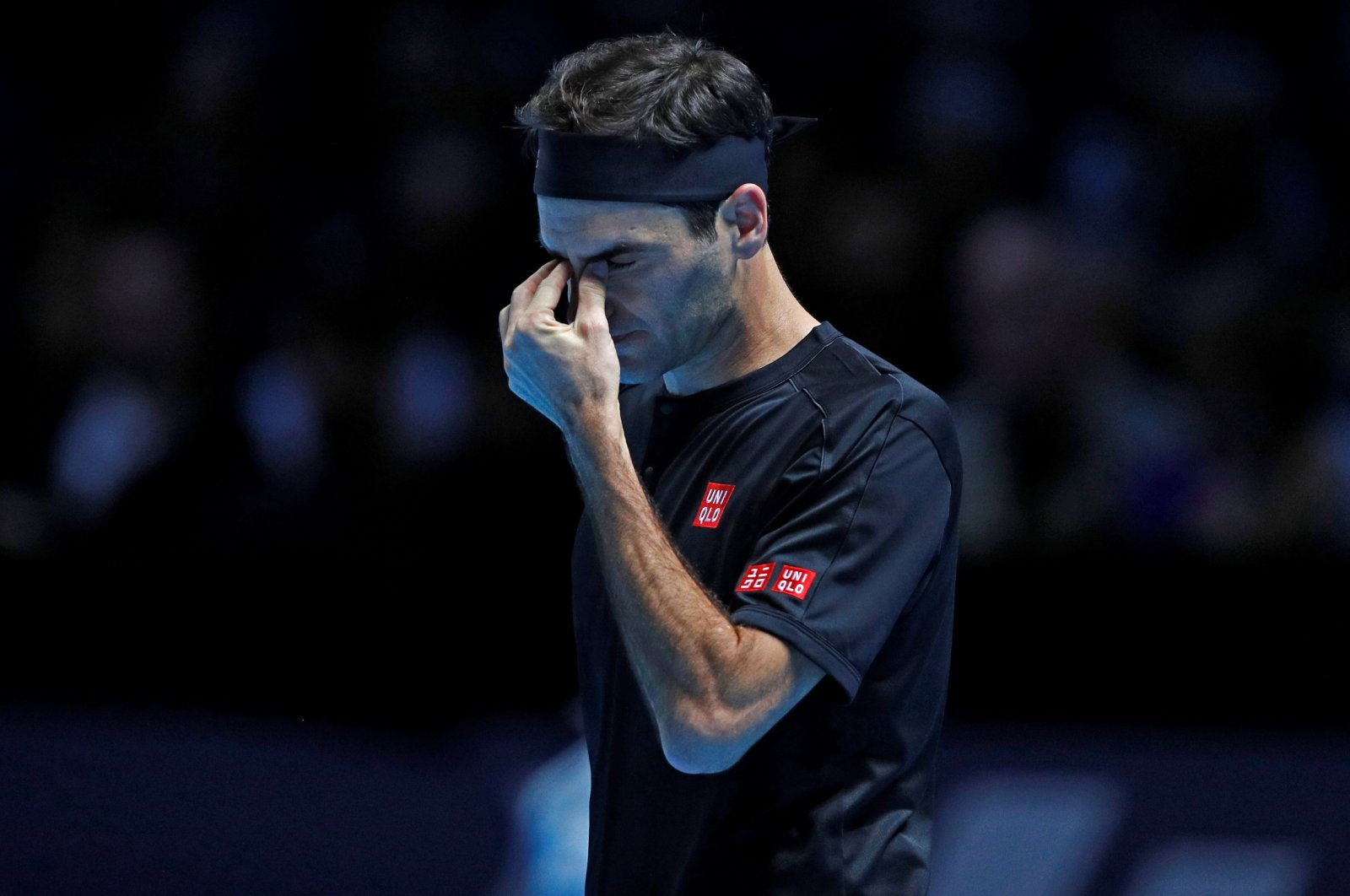 Roger Federer gestures during an ATP World Tour Finals tournament match at the O2 Arena in London, Britain, Nov. 10, 2019. (AFP Photo)