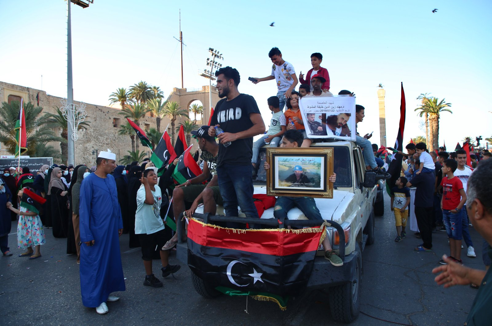People celebrate with Libyan national flags in the capital Tripoli's Martyrs' Square after fighters loyal to the U.N.-recognized Government of National Accord (GNA) captured the town of Tarhuna, June 5, 2020. (AA Photo)