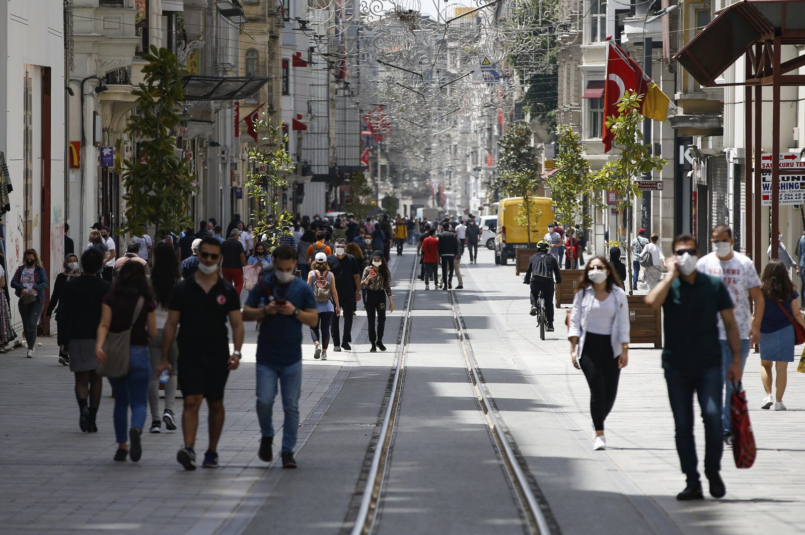 People walk on Istiklal Avenue, one of the main shopping streets in Istanbul, Turkey, during the coronavirus outbreak, May 15, 2020. (AP Photo)
