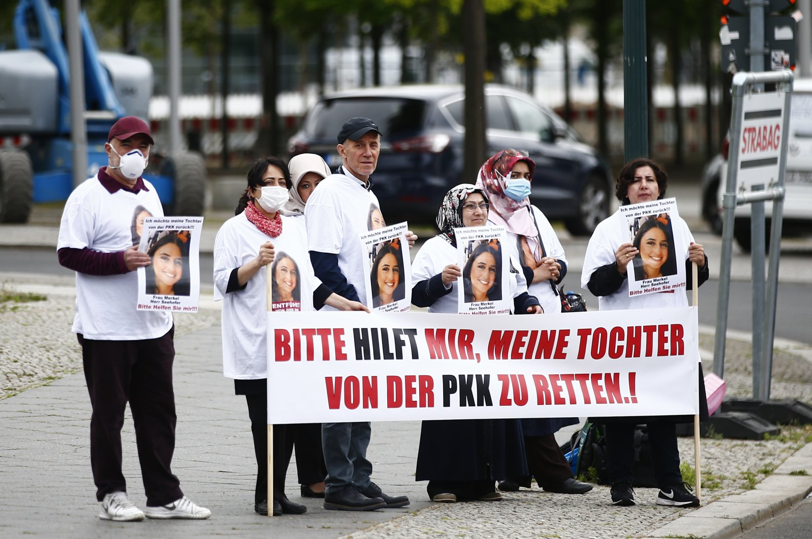 "Maide T. (first one on the right), alongside with her supporters who wore T-shirts with a picture of her daughter Nilufer T. with the words ""kidnapped by PKK"" stage a protest outside the German Chancellery, Berlin, June 10, 2020. (AA)"