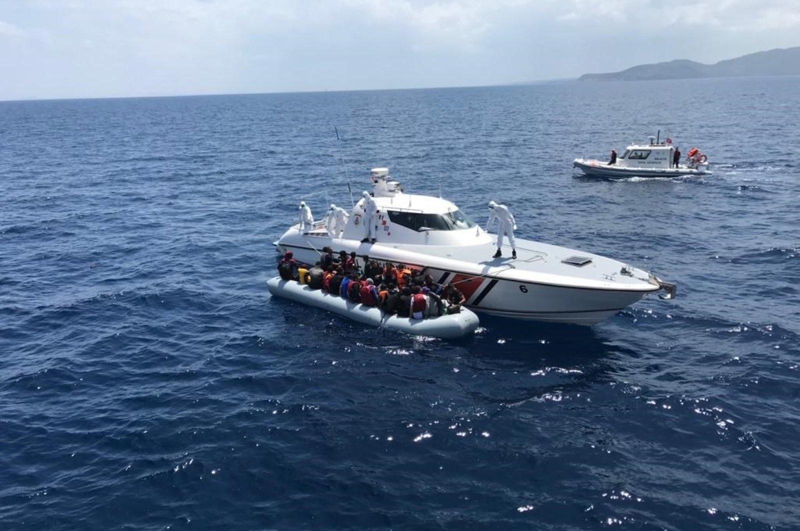 Turkey's Coast Guard Command has rescued hundreds of migrants and asylum-seekers off the Aegean coast after they were forced by Greece into Turkish territorial waters. (AA Photo)