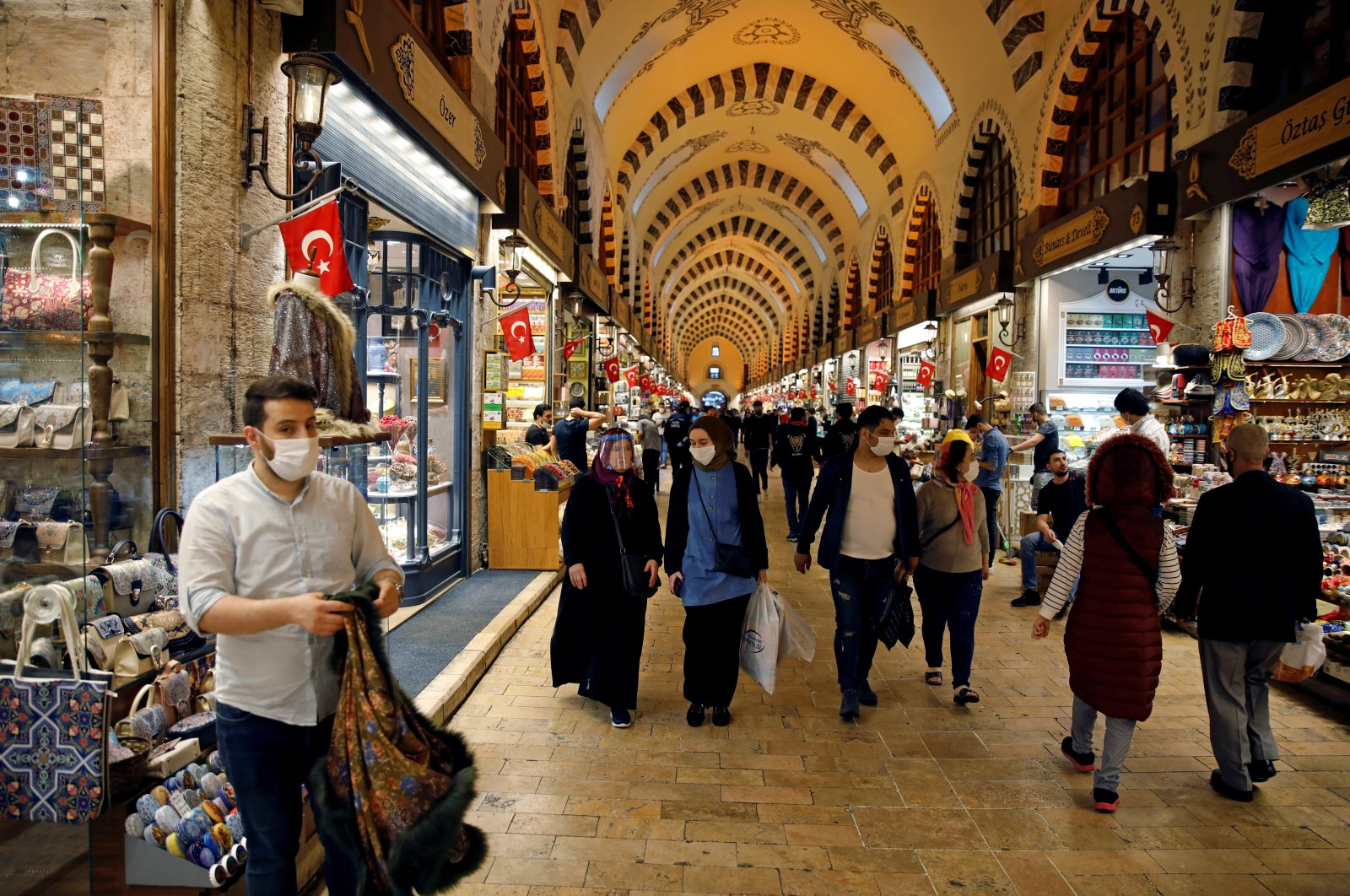 People wearing protective face masks walk at the spice market, also known as the Egyptian Bazaar, Istanbul, June 1, 2020. (REUTERS Photo)
