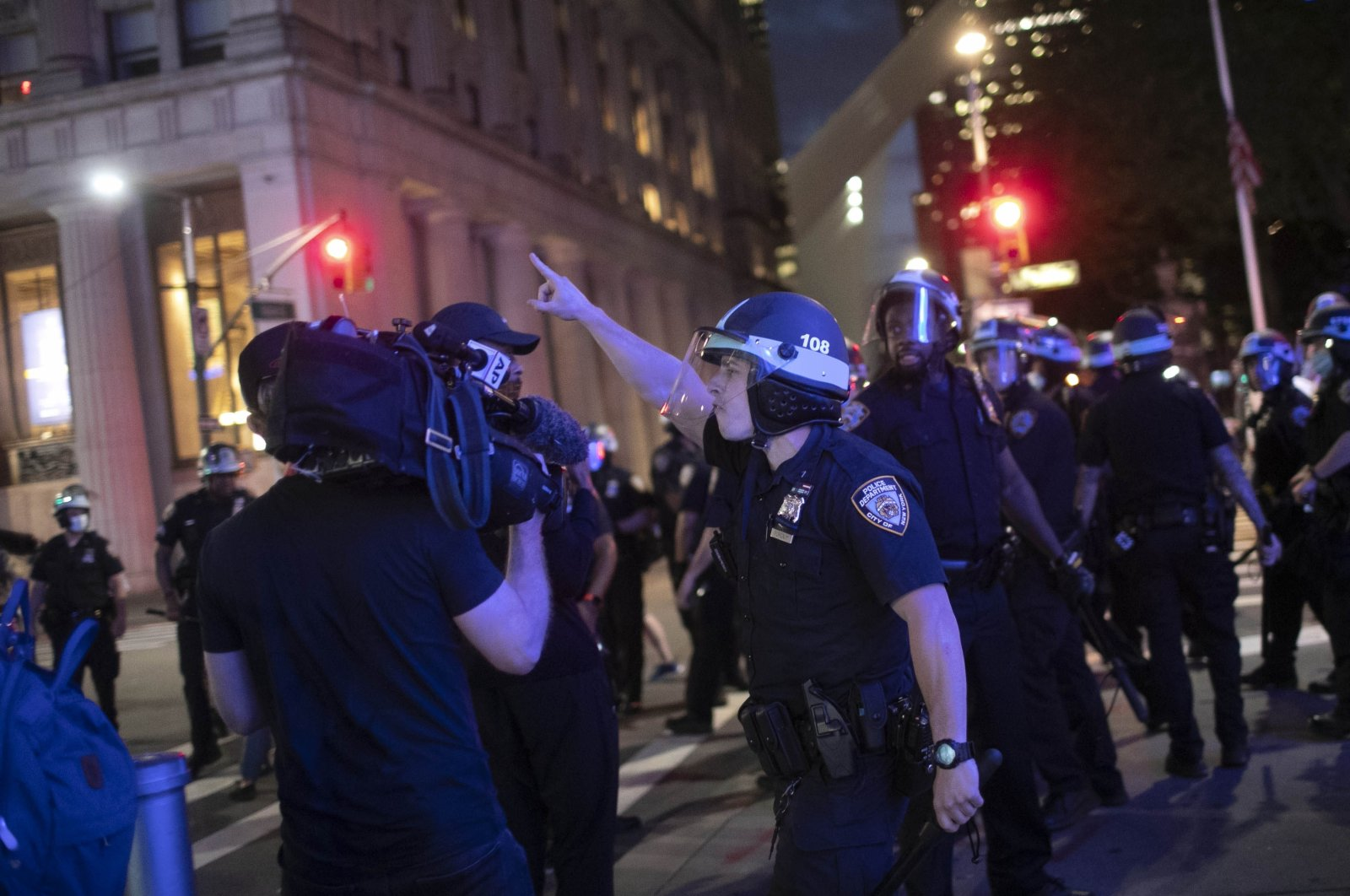 A police officer shouts at Associated Press videojournalist Robert Bumsted, Tuesday, June 2, 2020, in New York. (AP Photo)
