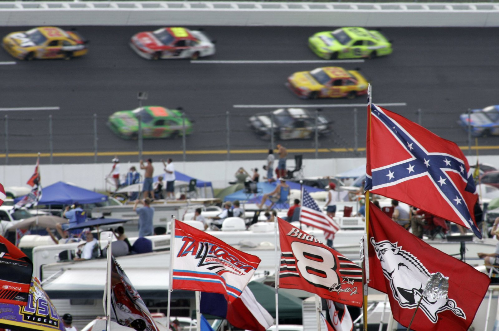 A Confederate flag flies in the infield as cars come out of Turn 1 during a NASCAR auto race at Talladega Superspeedway in Talladega, Ala., Oct. 7, 2007. (AP File Photo)