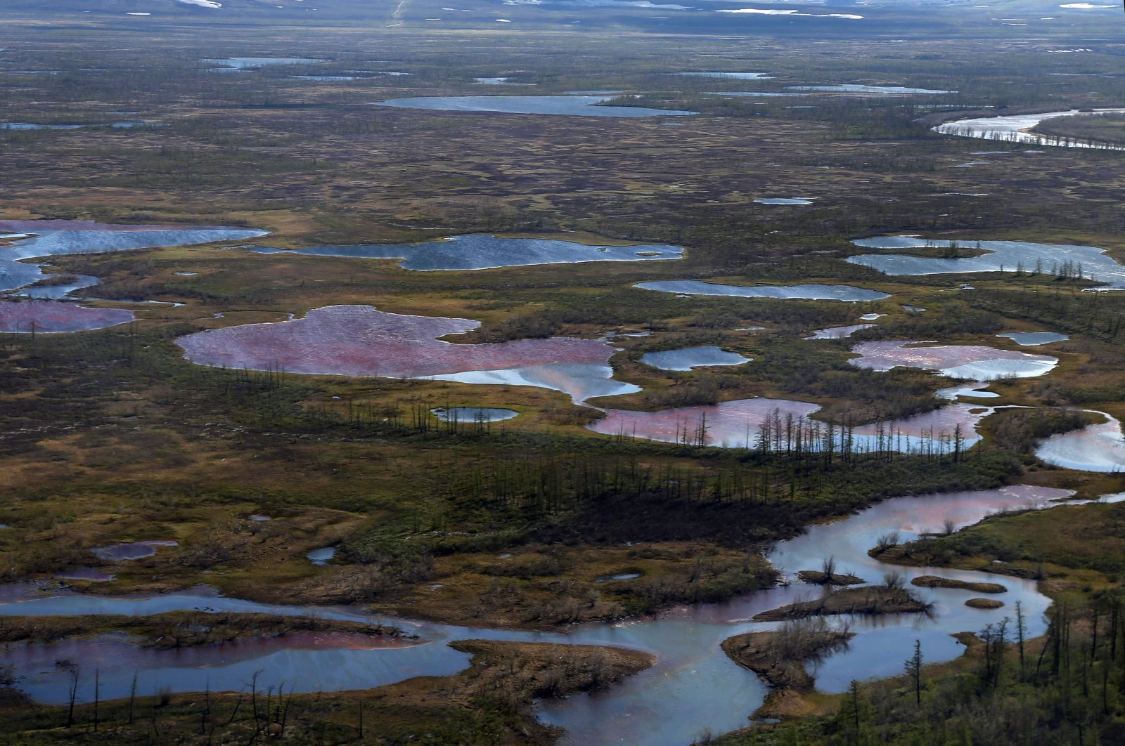 An aerial view shows the pollution in a river outside Norilsk, June 6, 2020. (AFP Photo)