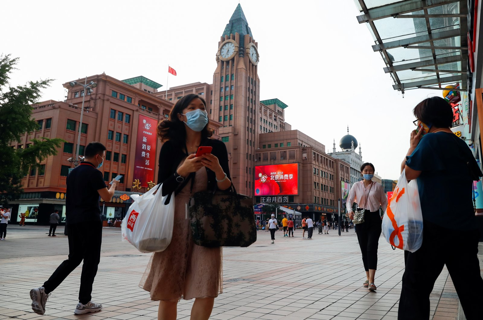 People walk past a department store of the Wangfuijing Group in Beijing, China, June 10, 2020. (Reuters Photo)
