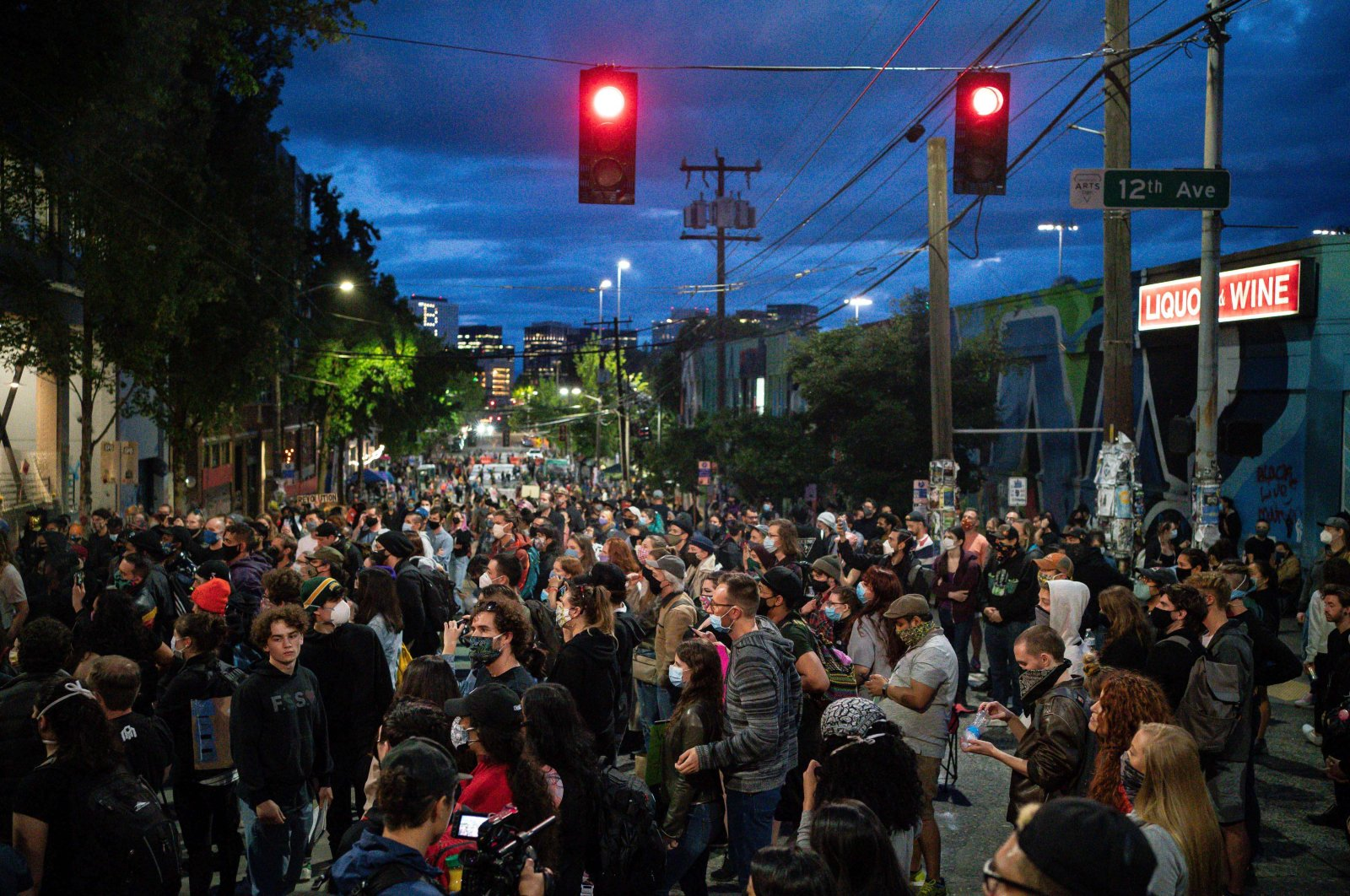 "People listen as a band plays a free show in front of the Seattle Police Departments East Precinct in the so-called ""Capitol Hill Autonomous Zone,"" Seattle, U.S., June 10, 2020. (AFP Photo)"