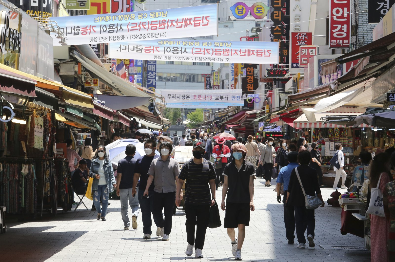 People walk in a shopping district in Seoul, South Korea, June 11, 2020. (AP Photo)