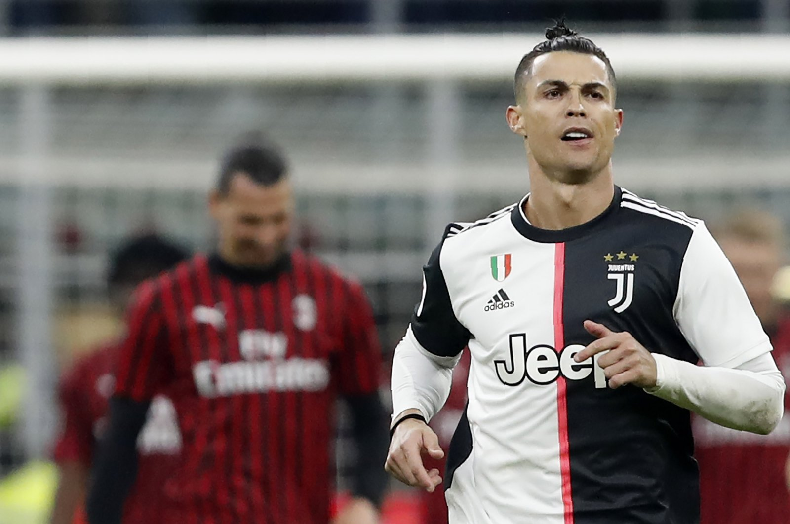 Juventus' Cristiano Ronaldo celebrates after scoring a penalty against AC Milan during an Italian Cup match in Milan, Italy, Feb. 13, 2020. (AP Photo)