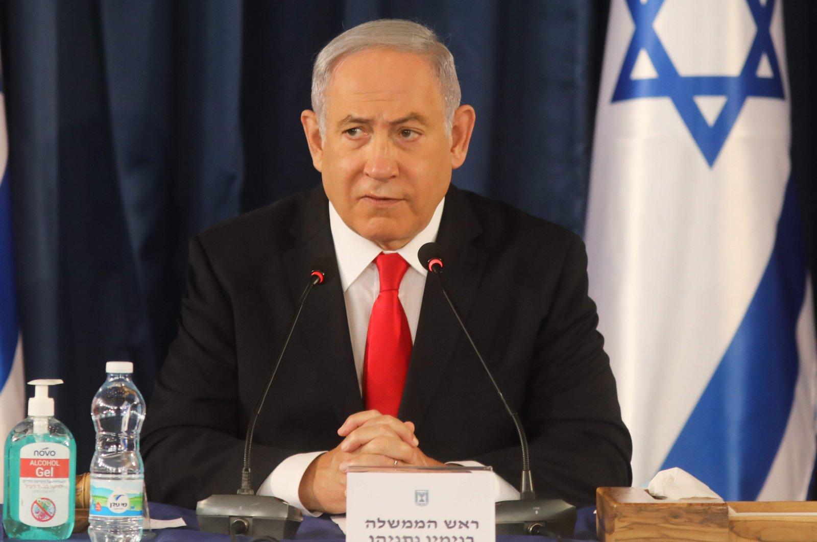Israeli Prime Minister Benjamin Netanyahu chairs the weekly Cabinet meeting in Jerusalem, June 7, 2020. (AFP Photo)