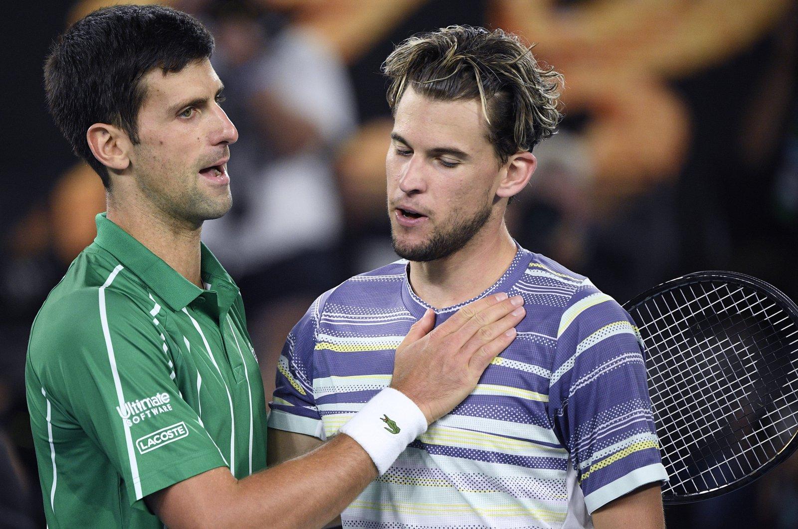 Novak Djokovic (L) congratulated by Dominic Thiem after winning the Australian Open tennis championship in Melbourne, Australia, Feb. 2, 2020. (AP Photo)