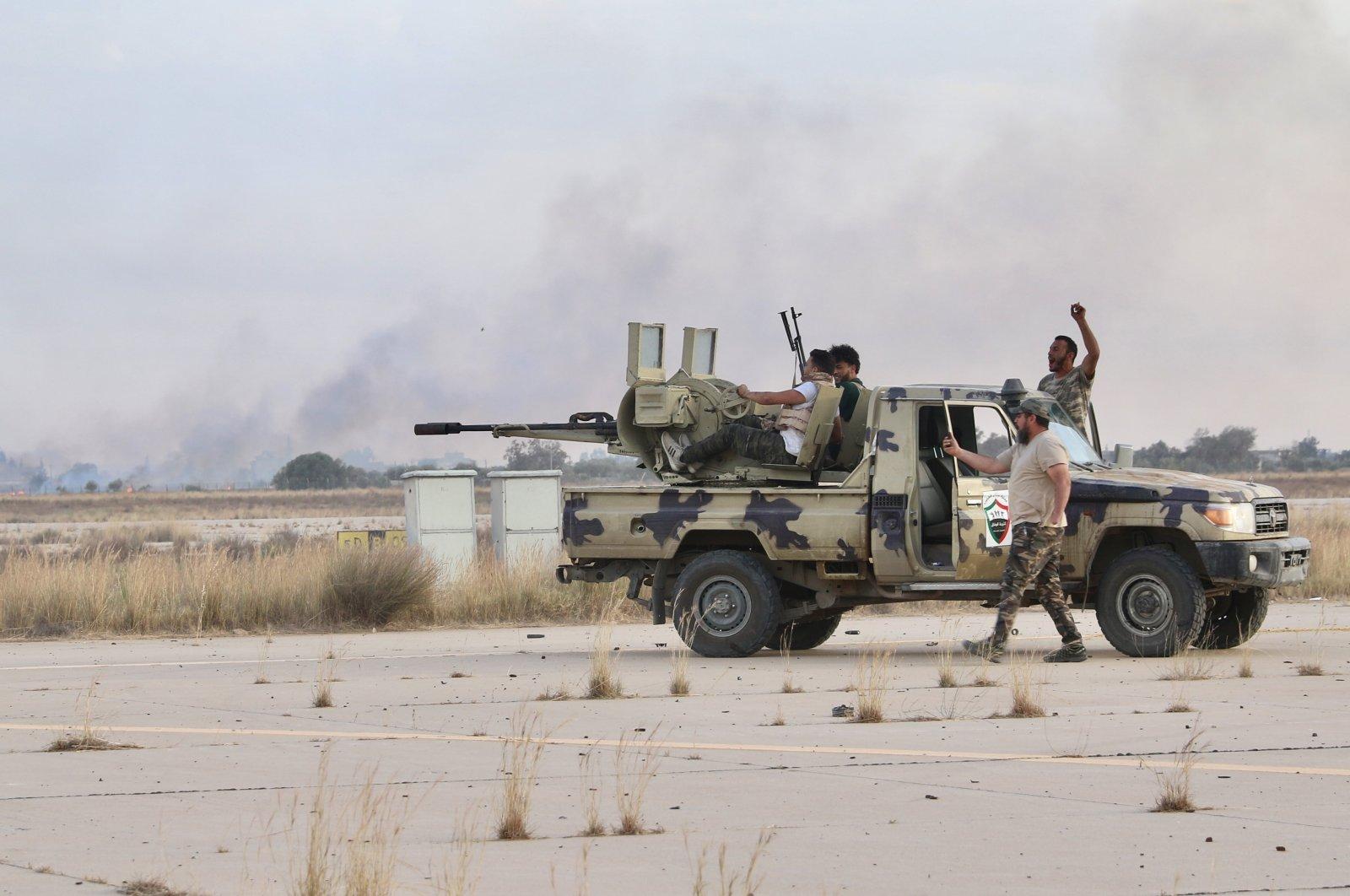 Libyan Army members arrive in Libya's Bani Walid, from which militias loyal to putschist Gen. Khalifa Haftar fled, June 8, 2020. (AA Photo)