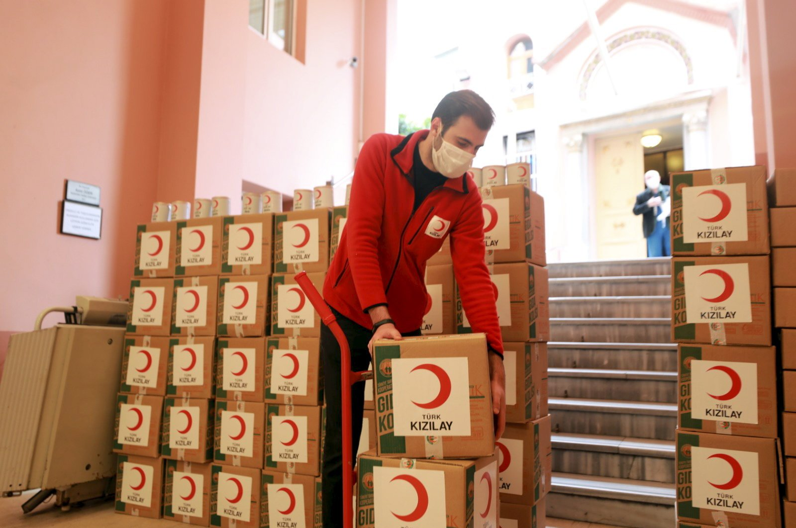 A Turkish Red Crescent worker delivers aid to an Armenian church in Istanbul, Turkey, May 9, 2020. (Photo by Mustafa Kaya)