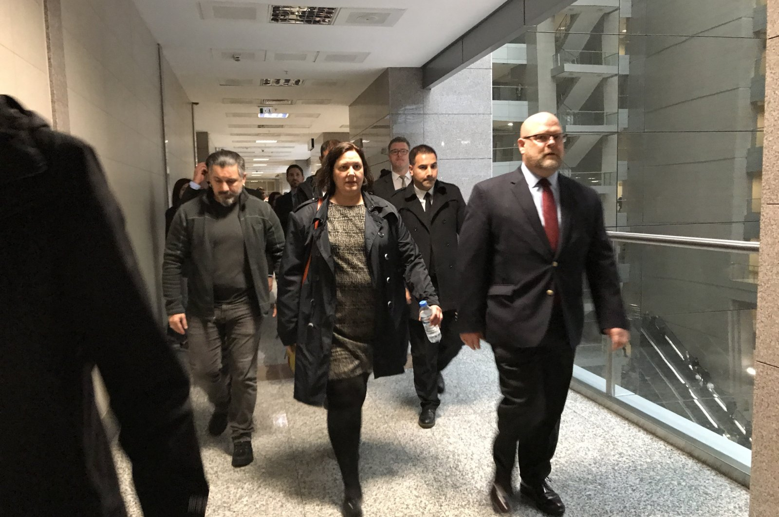 U.S. Consul General Daria Darnell (C) and Charge D'Affaires of the U.S. Embassy in Ankara Jeffrey Hovenier (R) in the courthouse where the trial of Metin Topuz would be held, Istanbul, March 10, 2020. (Photo by Fatih Ulaş)
