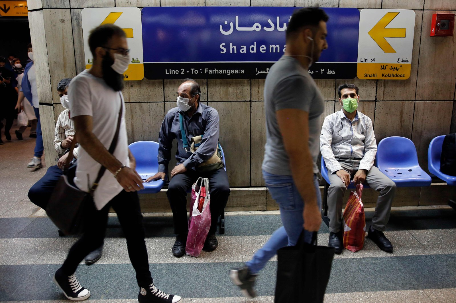 Iranians wearing face masks are pictured in a subway station in the capital Tehran on June 10, 2020. (AFP Photo)