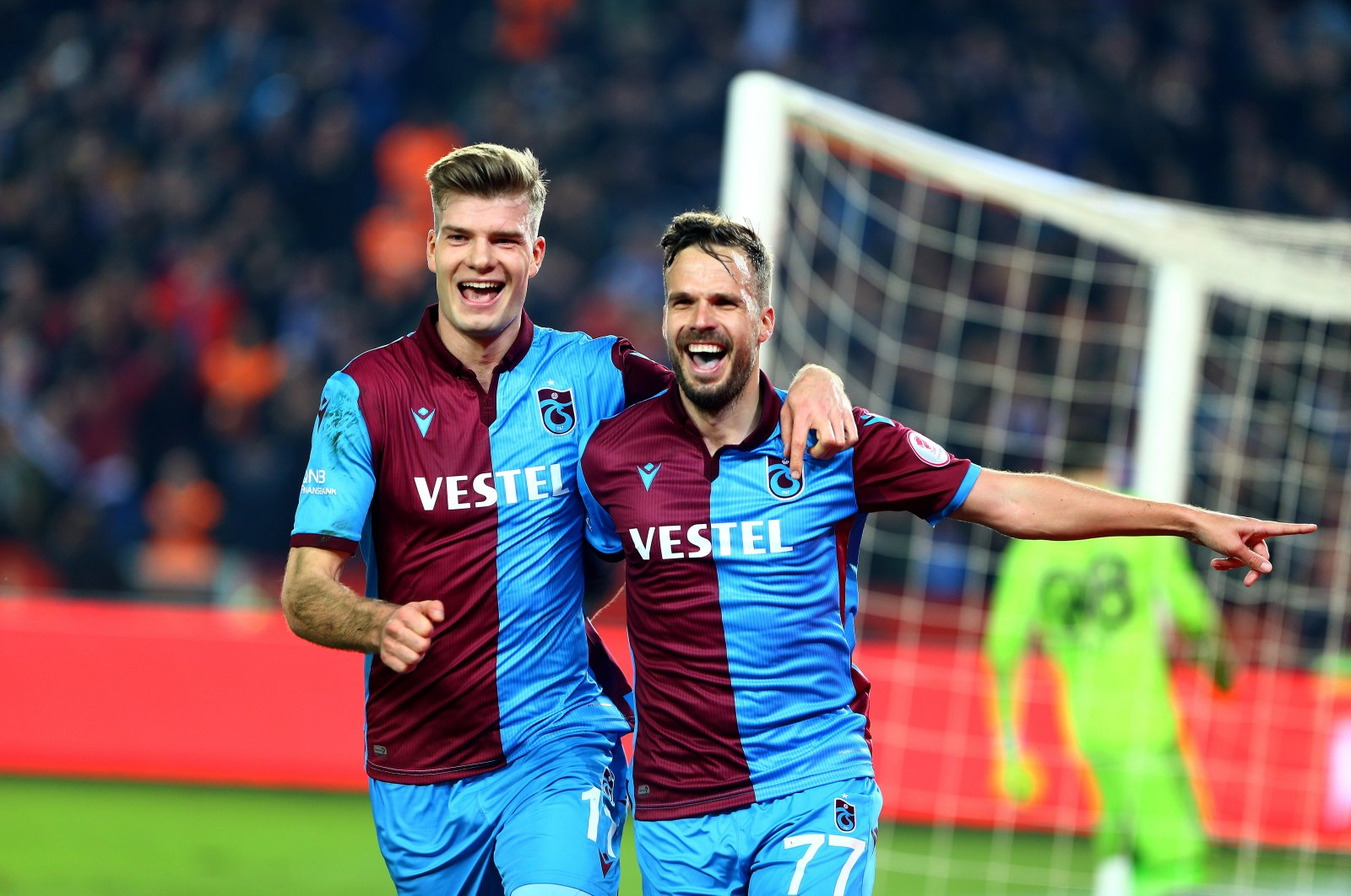 Trabzonspor's Alexander Sorloth and Filip Novak celebrate a goal during Ziraat Turkish Cup match against Fenerbahçe in Trabzon, Turkey, March 3, 2020.