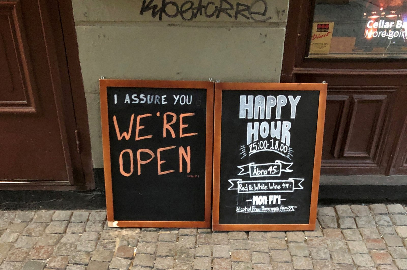 A sign assures people that the bar is open during the coronavirus outbreak, outside a pub in Stockholm, March 26, 2020. REUTERS