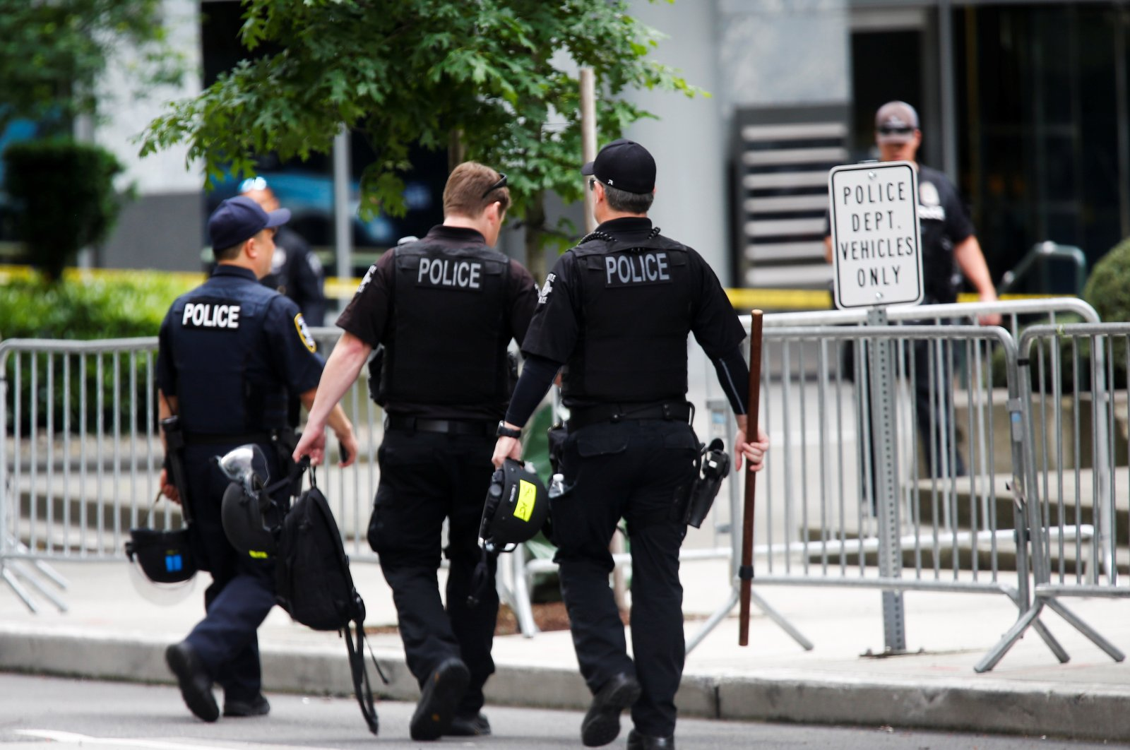 Seattle Police officers carry gear as they walk towards the Seattle Police Department's West Precinct in Seattle, Washington, U.S. June 10, 2020. (Reuters Photo)