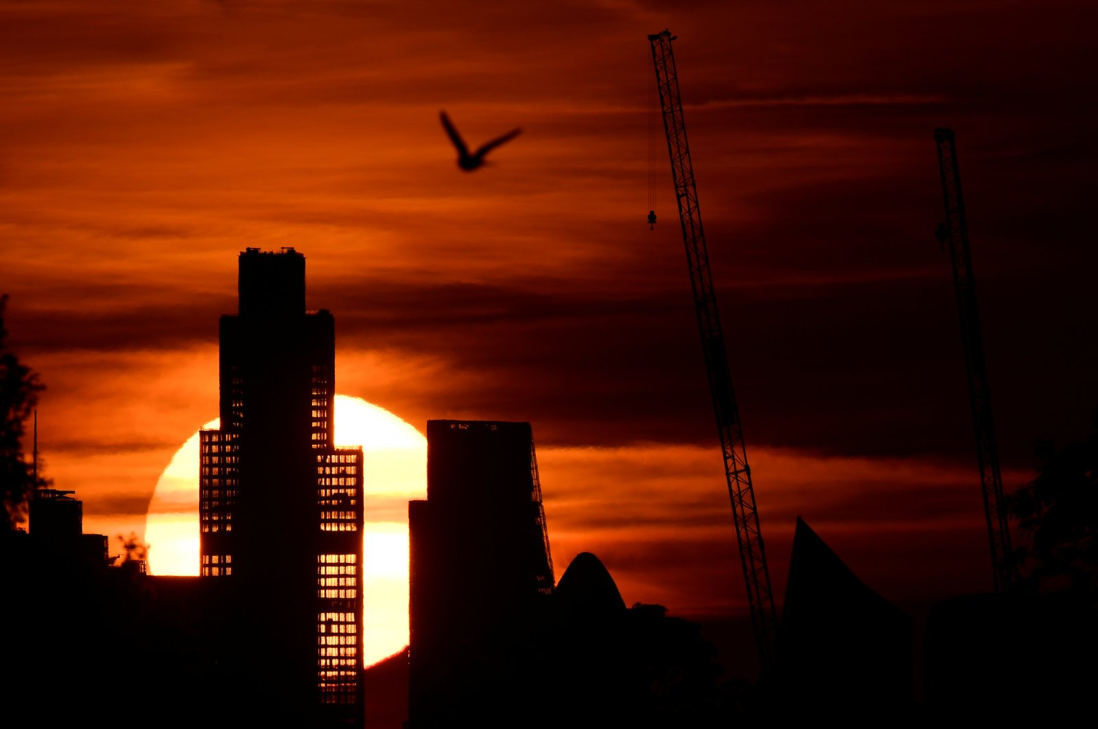 The sun rises behind skyscrapers in London's financial district, as the spread of the coronavirus continues in Britain, June 2, 2020. (Reuters Photo)