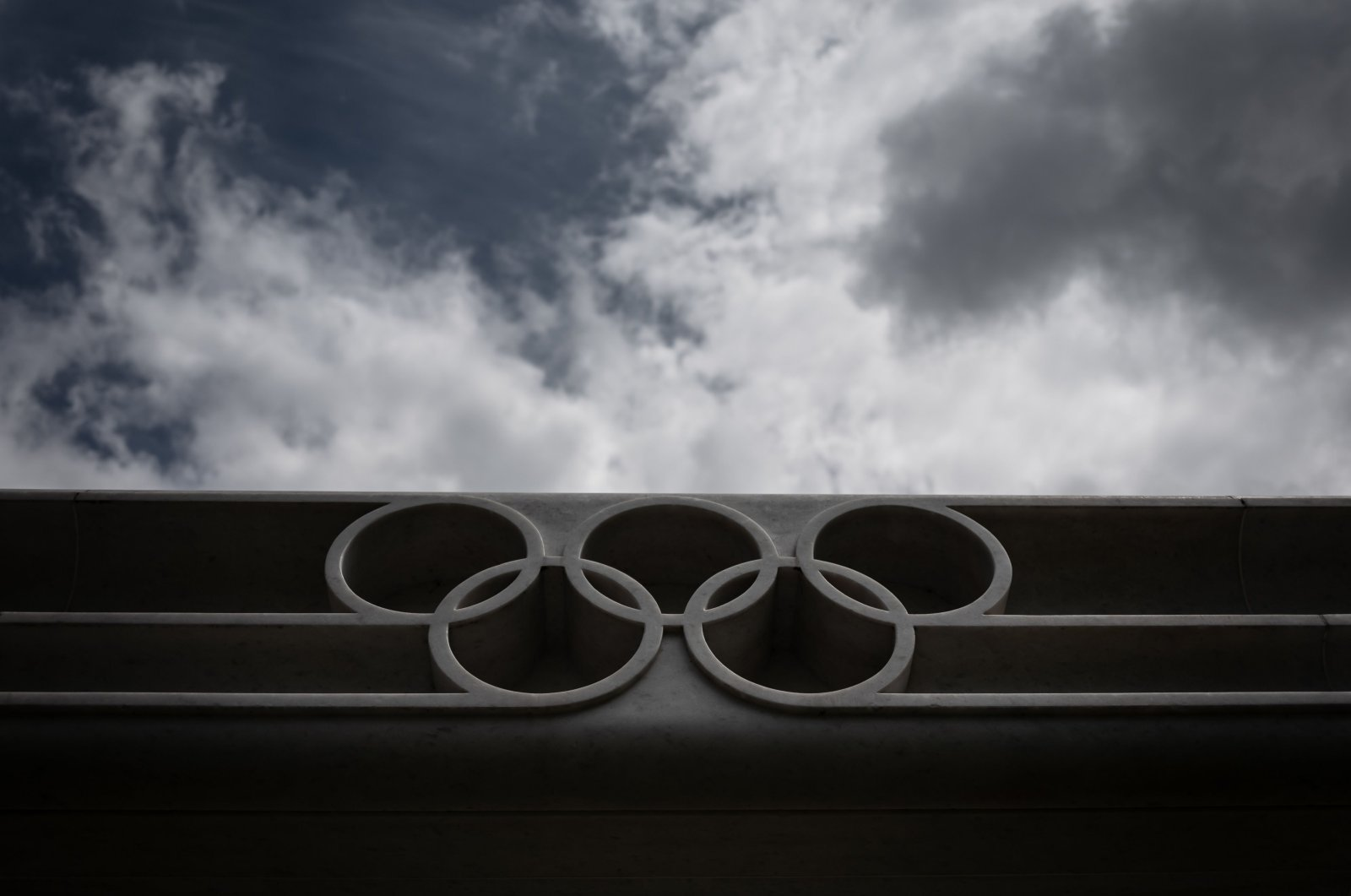 The Olympic rings logo at the entrance of the headquarters of the International Olympic Committee (IOC) in Lausanne, Switzerland, June 8, 2020. (AFP Photo)