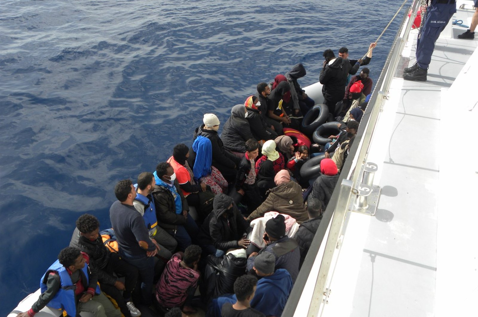 Turkey's Coast Guard Command rescues 42 asylum-seekers from a boat pushed back by Greece's Hellenic Coast Guard, in Izmir province's Foça district, Turkey, June 12, 2020. (DHA Photo)