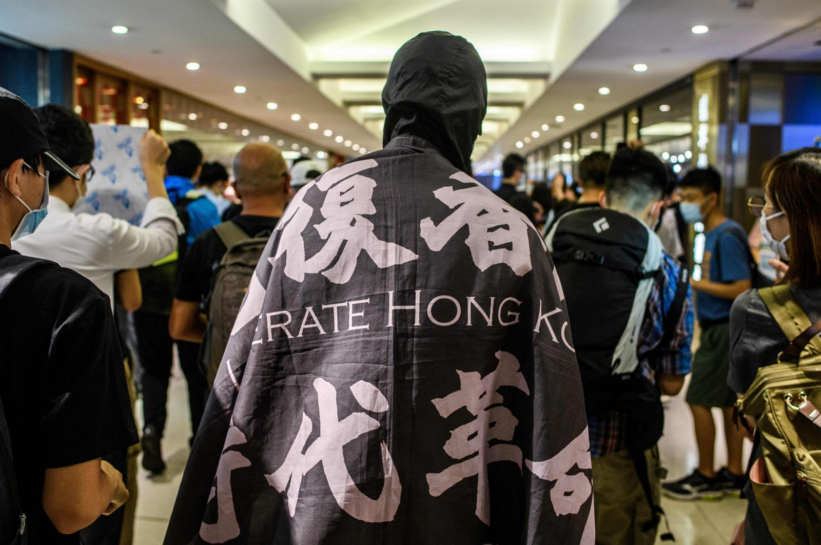 "Supporters attend a pro-democracy ""Lunch With You"" rally in a shopping mall in Hong Kong, June 12, 2020. (AFP Photo)"