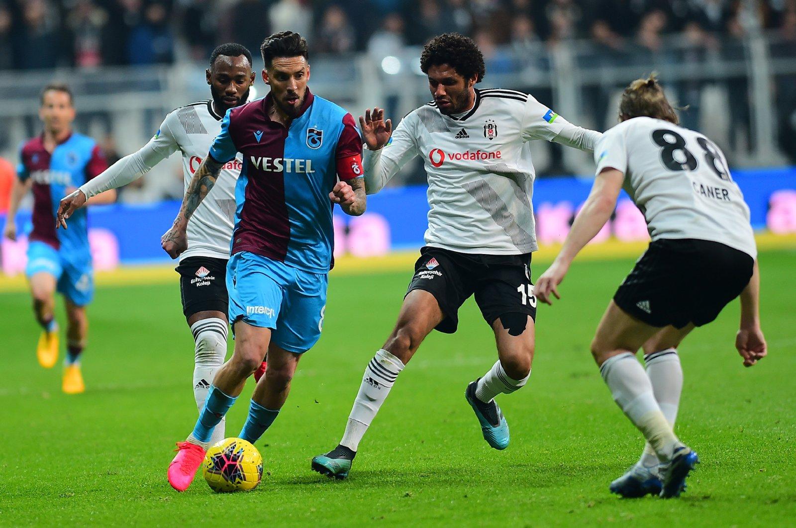 Trabzonspor's Sosa dribbles past Beşiktaş players during a Süper Lig match in Istanbul, Turkey, Feb. 22, 2020. (Photo by Turgut Doğan)