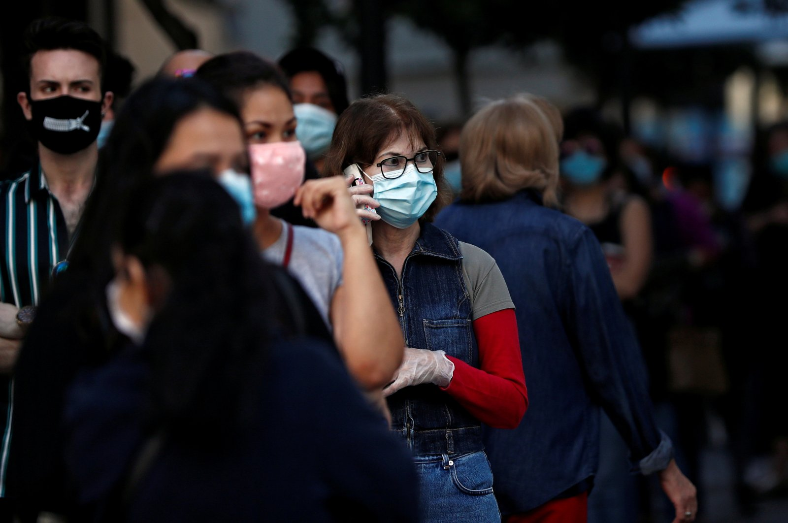 People wearing face masks queue to enter a reopened Primark store as Madrid eases lockdown restrictions following the coronavirus disease (COVID-19) outbreak, in Madrid, Spain, June 11, 2020. (Reuters Photo)