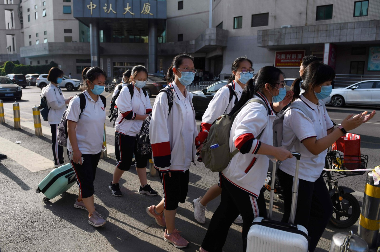 High school students leave at the end of their school day in Beijing, June 12, 2020. (AFP Photo)