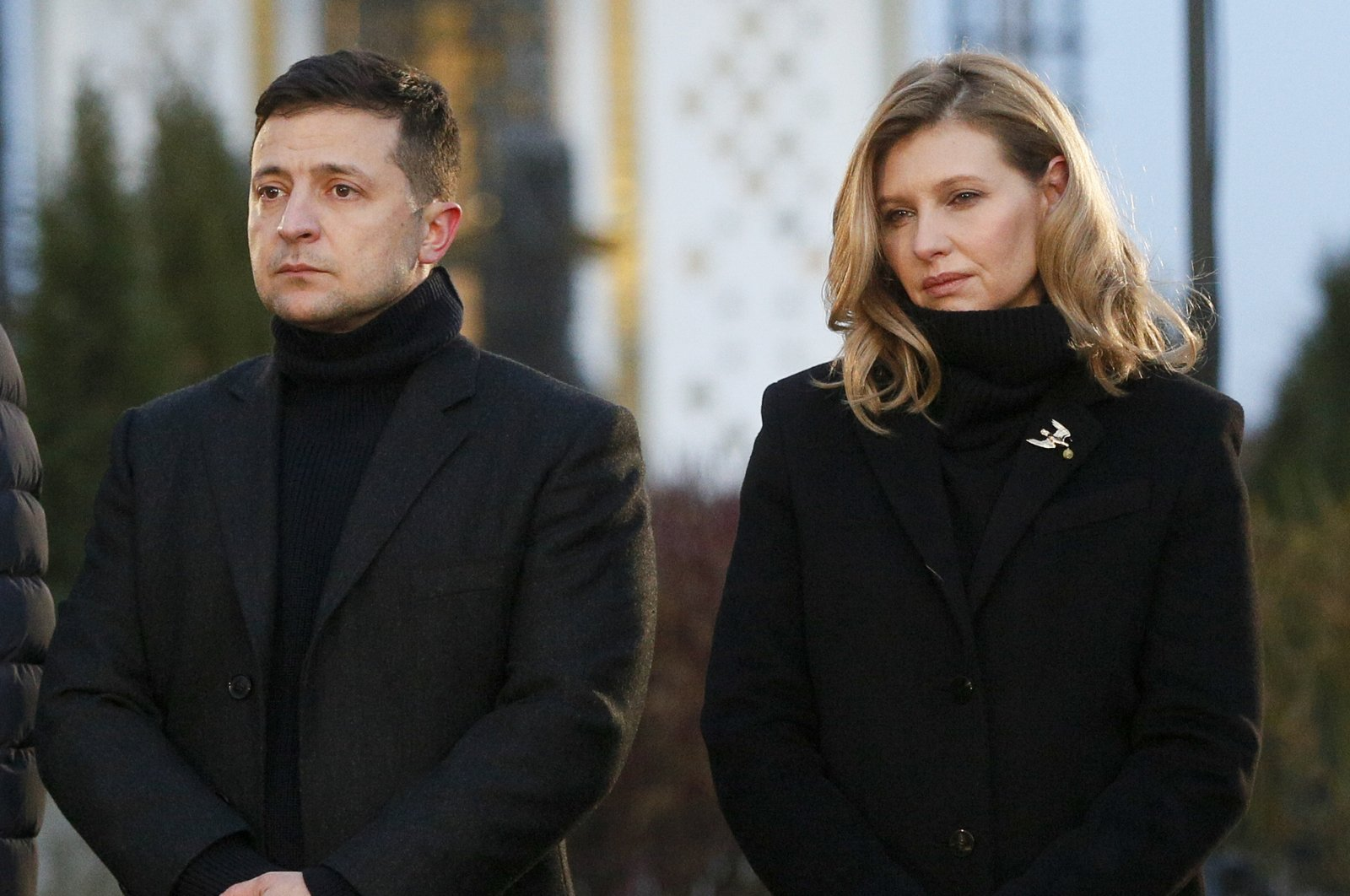 President Volodymyr Zelenskiy and his wife Olena pay tribute at a monument to victims of the Great Famine in Kyiv, Ukraine, Nov. 23, 2019.  (AP Photo)