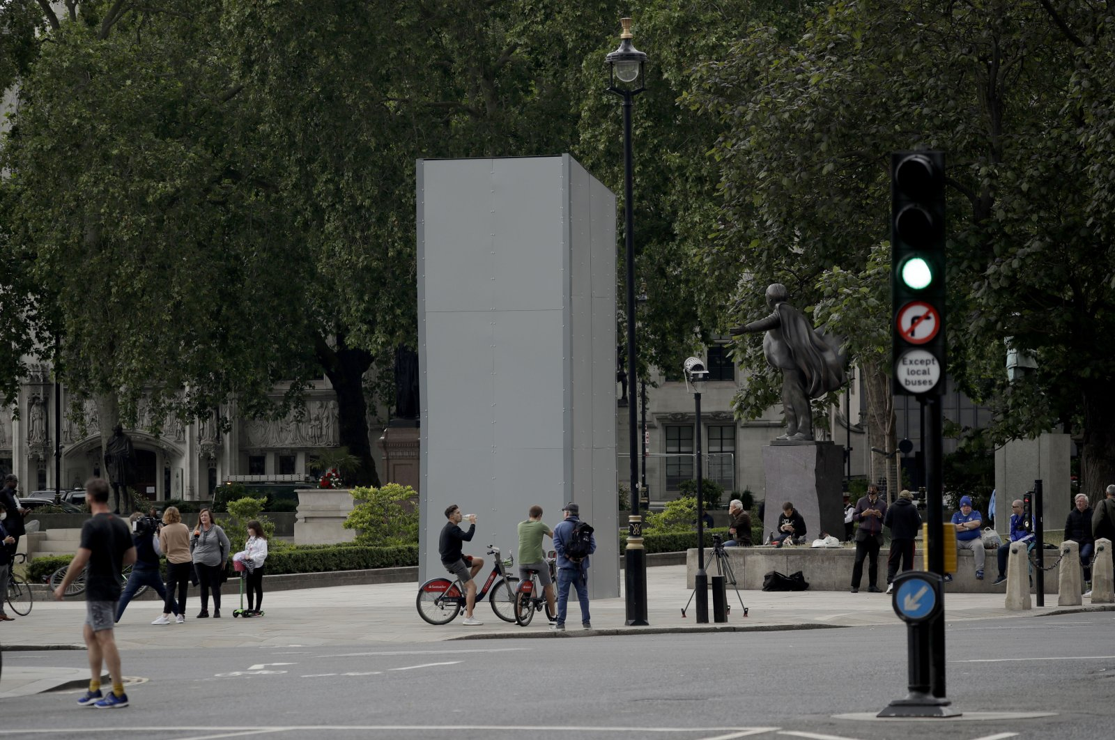 A protective screen put up late Thursday encloses the statue of Britain's World War II Prime Minister Winston Churchill ahead of expected rival demonstrations by anti-racism and far-right protesters in London, June 12, 2020. (AP Photo)