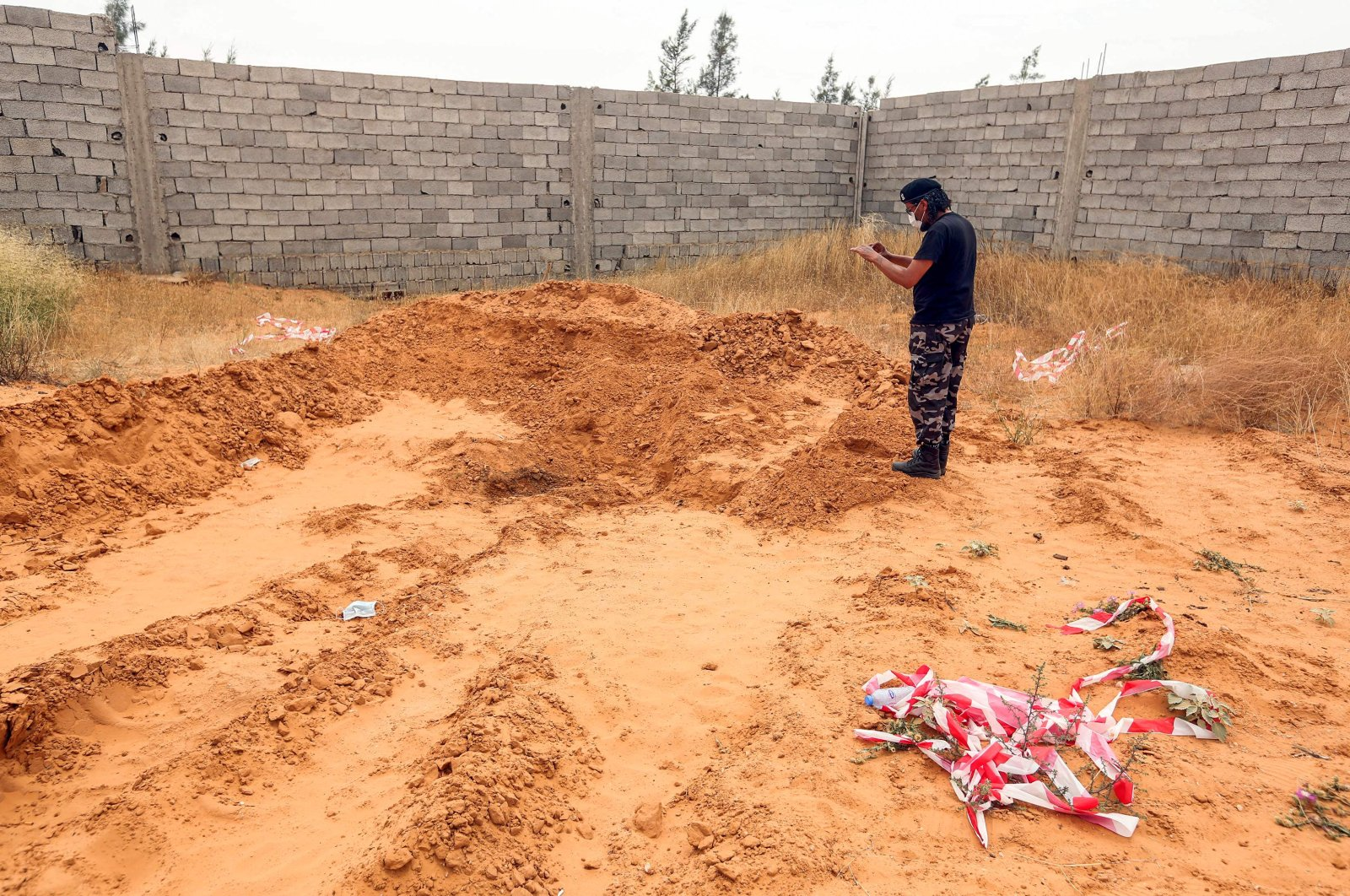 A member of security forces affiliated with the Interior Ministry of Libya's Government of National Accord (GNA) stands at the reported site of a mass grave in Tarhuna, 65 kilometers southeast of capital Tripoli, Libya, June 11, 2020. (AFP Photo)