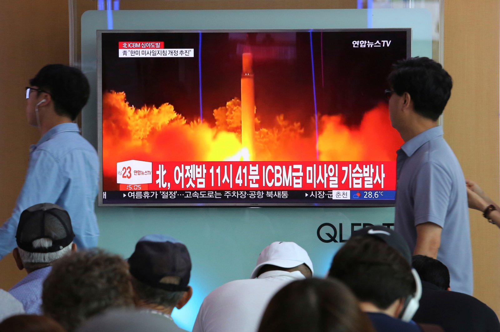 People watch a TV news program showing an image of North Korea's latest test launch of an intercontinental ballistic missile (ICBM), at the Seoul Railway Station in Seoul, South Korea, July 29, 2017. (AP Photo)