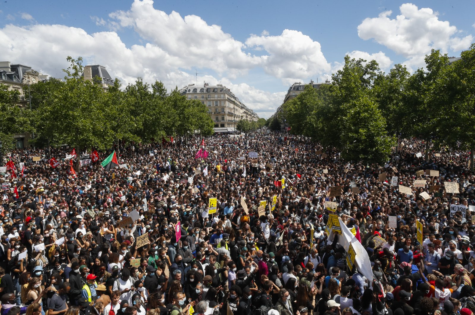 Thousands of people demonstrate against police brutality and racism in Paris, France, Saturday, June 13, 2020, prior to a march organized by supporters of Adama Traore, who died in police custody in 2016 in circumstances that remain unclear despite four years of back-and-forth autopsies. (AP Photo)