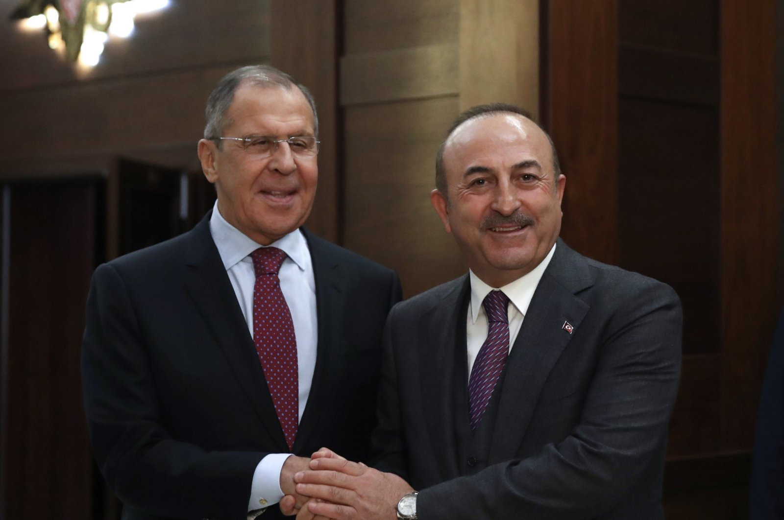Foreign Minister Mevlüt Çavuşoğlu shakes hand with his Russian counterpart, Sergey Lavrov, January 2, 2019. (AA Photo)