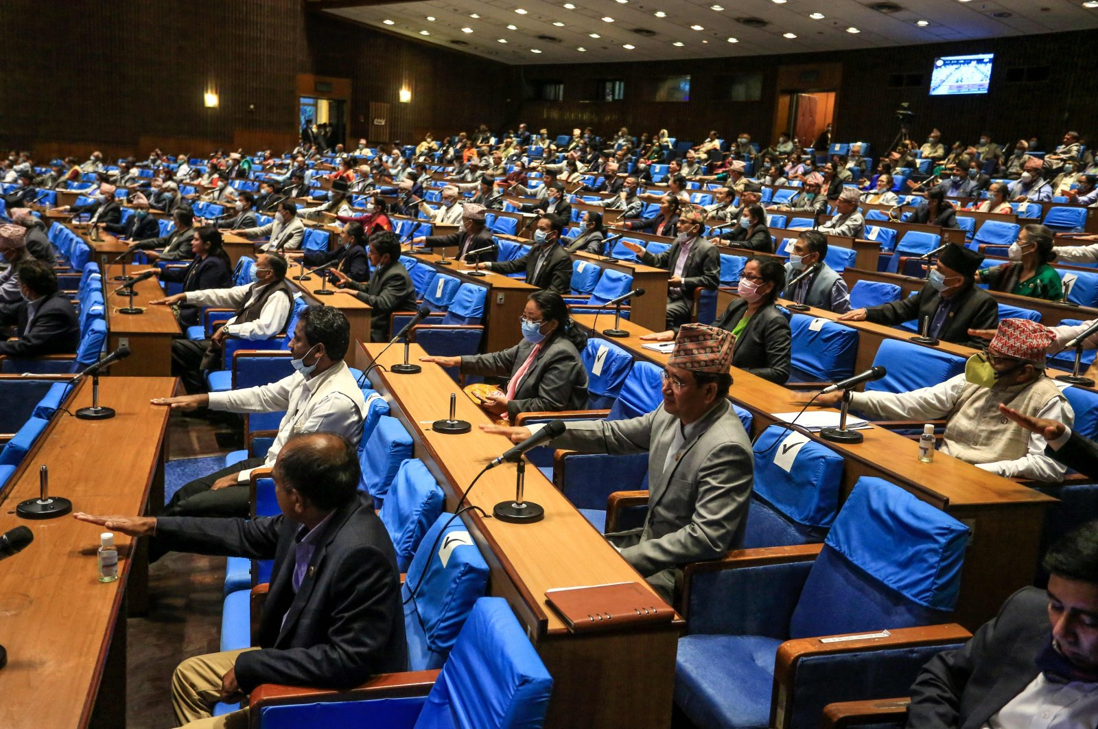 Nepal's House of Representatives members gesture as they vote on an amendment to update the national emblem with a new controversial political map in Kathmandu on June 13, 2020. (AFP Photo)